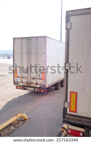 Trucks are loaded at the warehouse - stock photo