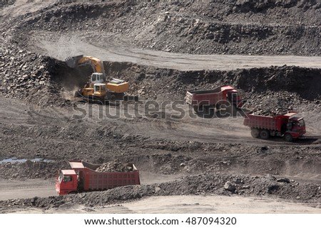 trucks carry ore open pit