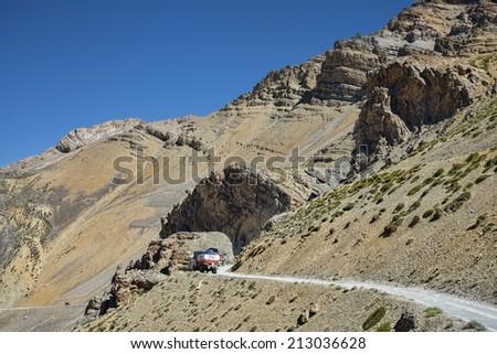 trucks going on mountain road - stock photo