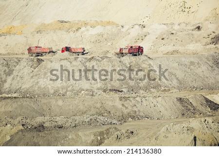 trucks in a coal mine - stock photo