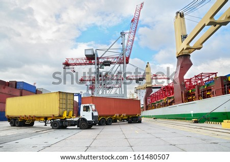 Trucks in container terminal in a harbor