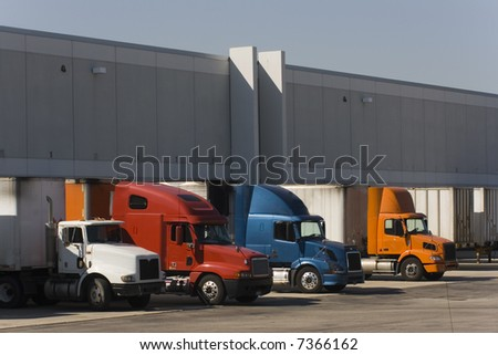 Trucks in docks - stock photo