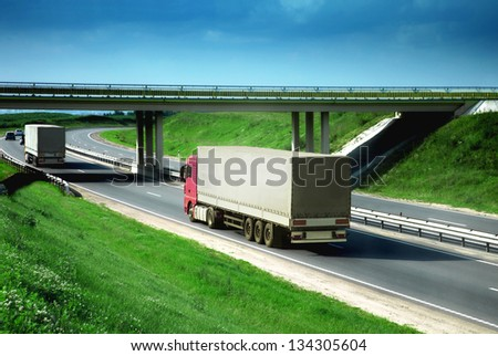 trucks on a road - stock photo