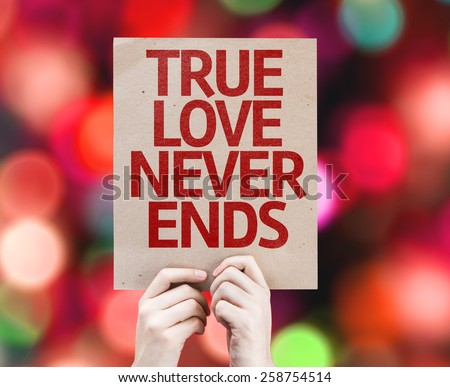True Love Never Ends card with colorful background with defocused lights - stock photo