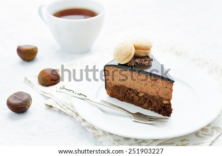 truffle cake with chestnut mousse on a white plate. tinting. selective focus