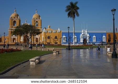 TRUJILLO, PERU - SEPTEMBER 2, 2014: Colourful colonial style buildings surrounding the Plaza de Armas in Trujillo, Peru. - stock photo