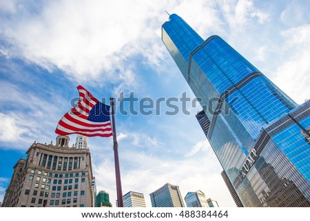Trump Tower in downtown Chicago with the USA flag flying nearbny on a hot summer's day
