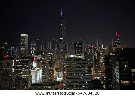 Trump Tower with lighted spire in downtown Chicago skyline take a dominate position.