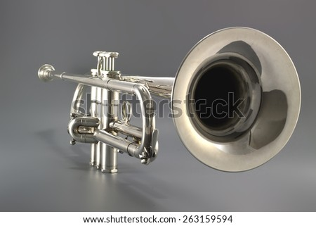 Trumpet close up well lighted in product photography studio - stock photo