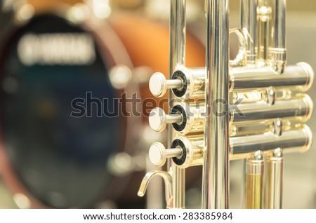 Trumpet on drum background - stock photo