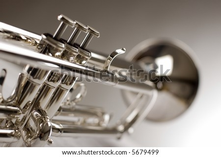 Trumpet on musical notes as background close up - stock photo