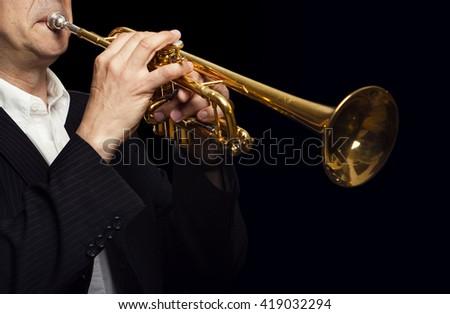 Trumpet Player on Black Background - stock photo