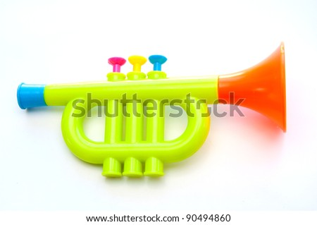 Trumpet toy for kids isolated on white background - stock photo