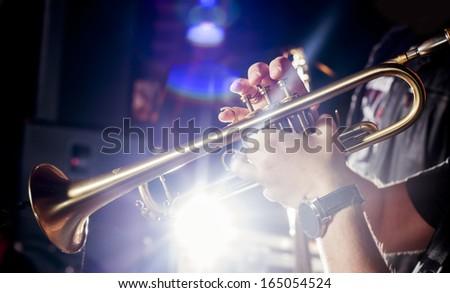 Trumpeter in a nightclub. - stock photo