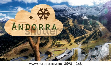 trunk and wooden sign indicating to andorra
