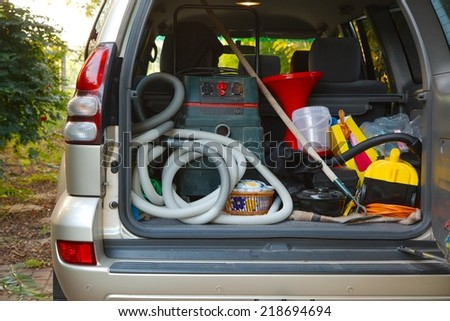 Trunk of a car loaded with equipment - stock photo