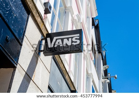 TRURO, CORNWALL, UK - JULY 17, 2016: Vans Shop Sign Logo. Architectural detail of local branch of Vans showing branding on store front. Name banner. British high street. Editorial Use Only. - stock photo