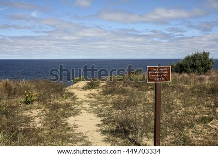 TRURO-SEPTEMBER 14: Unstable cliffs sign near Truro lighthouse in Cape Cod , Massachussets, USA on September  14, 2014. - stock photo