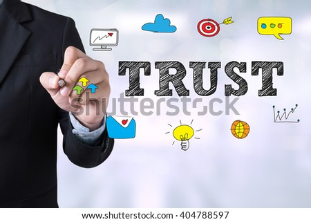 TRUST Businessman drawing Landing Page on blurred abstract background