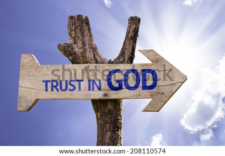 Trust in God wooden sign on a beautiful day - stock photo