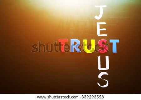 Trust Jesus concept, words on blackboard - stock photo