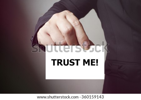 TRUST ME message on the card , business concept , business idea