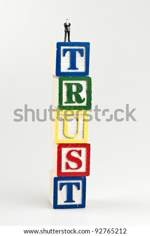 Trust word and toy business man - stock photo