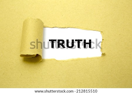 Truth text appearing behind torn brown paper. - stock photo