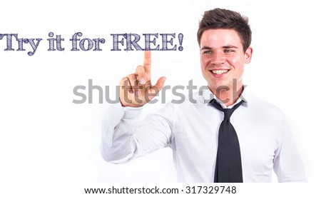 Try it for FREE! - Young smiling businessman touching text