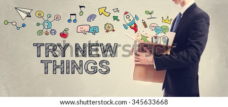 Try New Things concept with Businessman holding a cardboard box - stock photo