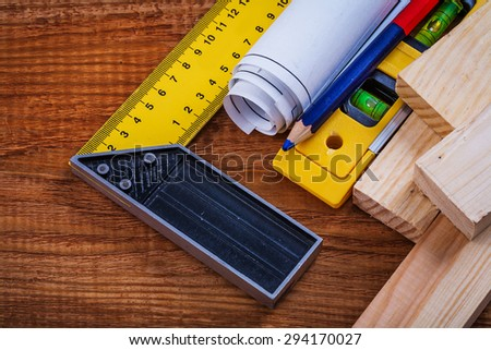 Try square pencil blueprints wooden studs construction level on vintage wood board maintenance concept.