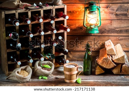 Trying fresh homemade beer in the cellar - stock photo
