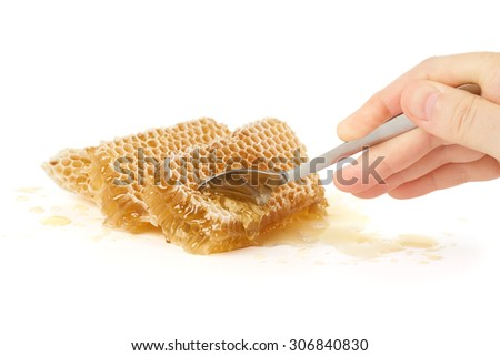 Trying fresh raw honey with a spoon                             - stock photo