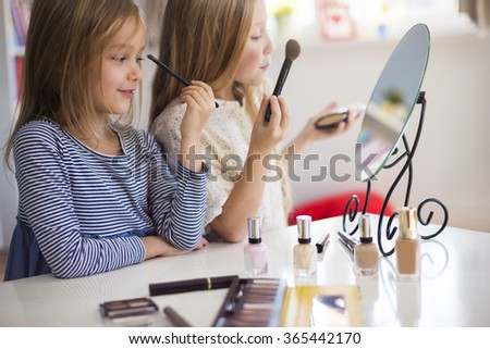 Trying to be like a mom - stock photo
