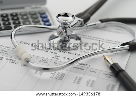 Trying to figure out the cost of healthcare benefits - stock photo