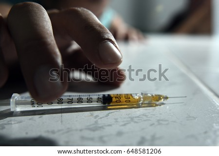 Trying to grab syringe with heroine overdose