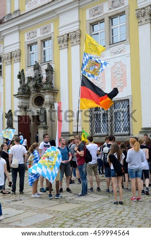 TRZEBNICA, POLAND - JULY 25: World Youth Day, pilgrims from Germany gather for mass in front of St. Jadwiga Sanctuary on 25th July 2016 in Trzebnica.