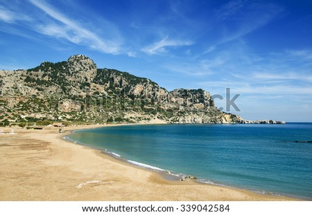 Tsambika (or Tsampika) is one of the most beautiful beaches on Rhodes. A long, broad beach with fine, golden sand. Very crowded at summer period. Rhodes  Island, Greece. - stock photo