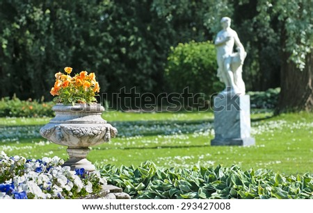 TSARSKOYE SELO, SAINT-PETERSBURG, RUSSIA - JUNE 29, 2015: Fragment of the Fountain-Vase in the Private Garden in the Catherine Park. On the background is The Zephyr Sculpture - stock photo