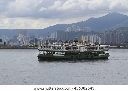 TSIM SHA TSUI , HONG KONG - JULY 1 : The ferry at the Victoria Harbour , Hong Kong on July 1 2016. This ship is popular public transportation between Kowloon and Hong Kong.