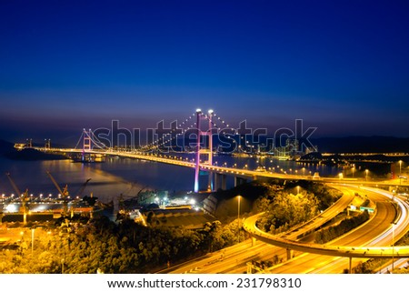 TSING MA BRIDGE, HONG KONG - MAR 18: Evening view of Tsing Ma Bridge at Tsing Yi, Hong Kong on Mar 18, 2014. It is the largest suspension bridge that has two decks to carry road and rail traffic. - stock photo
