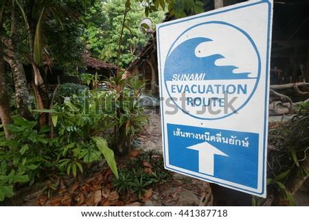 Tsunami Evacuation Route road sign with arrow at andaman Thailand  - stock photo