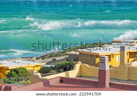 tsunami wave coming to town - stock photo