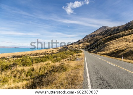 Tthe road along lake Pukaki leading to Mt Cook in New Zealand south island in the district of Canterbury.