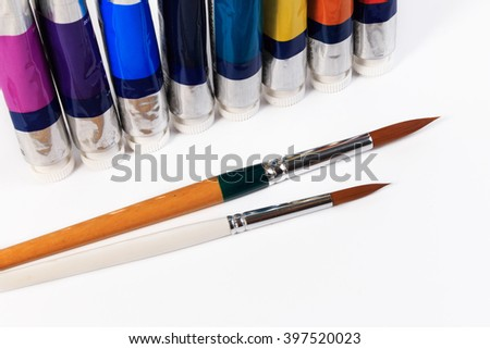Tube and brush of water color or oil color. Colorful color in tubes on a white background.