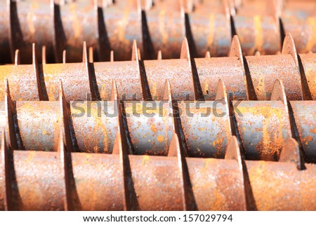 Tube of rust steel auger bunch before hot-dip galvanized. - stock photo