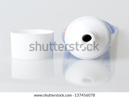 tube of toothpaste on a gray background - stock photo