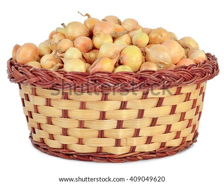 tuber onion in a wicker basket, isolated on white background
