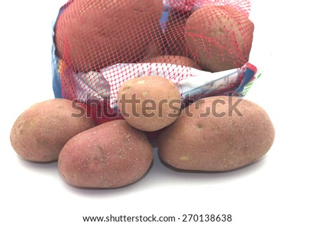 Tuber red ripe buried ready for cooking red potato - stock photo