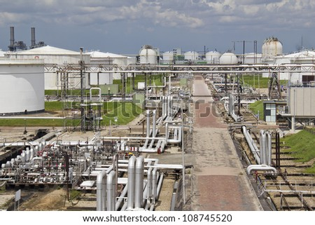 Tubes and silos at an oil refinery plant in Rotterdam, Holland - stock photo